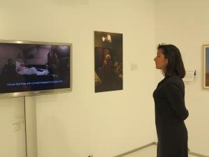 Juror Lora Sariaslan lost in contemplation over the work of award winner Nicolae Daniel Djamo.