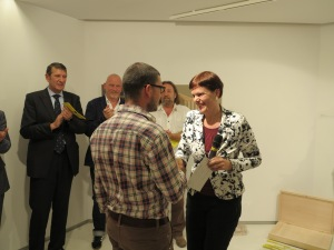 Eva Wirlitsch-Essl congratulating Alin Bozbiciu for receiving the Collector's Invitation and having the unique chance to participate in the final exhibition in December at the Essl Museum